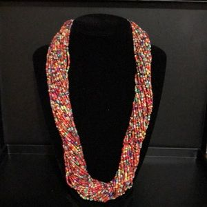 Jewelry - Multi colored beaded necklace with button clasp